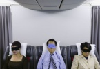 passengers-wearing-eyemasks-on-a-flight