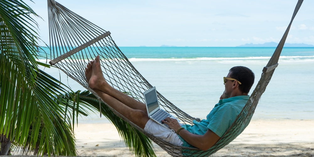 man in a hammock on the beach