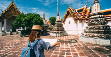 woman in Bangkok reading a map