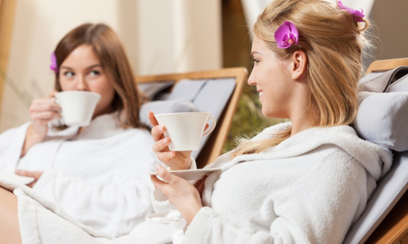 two women sipping tea at a spa