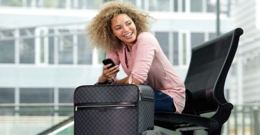 Woman knows which type of luggage to use at the airport