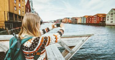 Woman taking photos in photogenic destinations